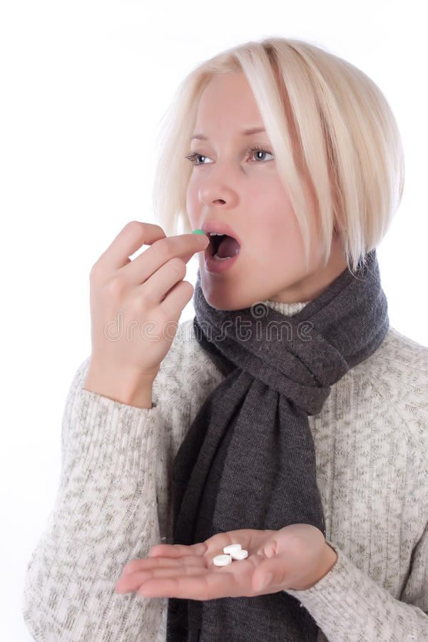 Young woman taking vitamins stock images