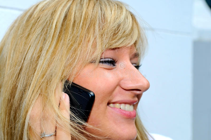 Young woman talking by mobile phone stock photos