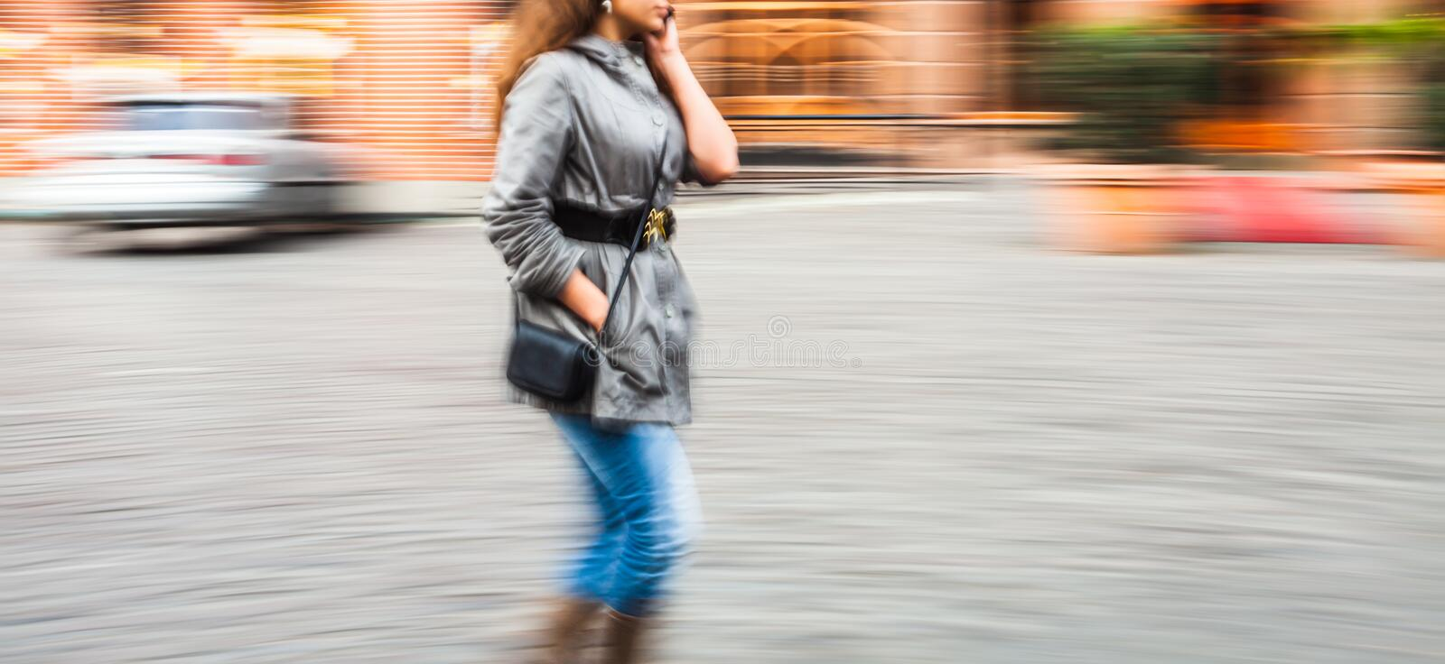 Young woman talking on a mobile phone in motion blur stock photos
