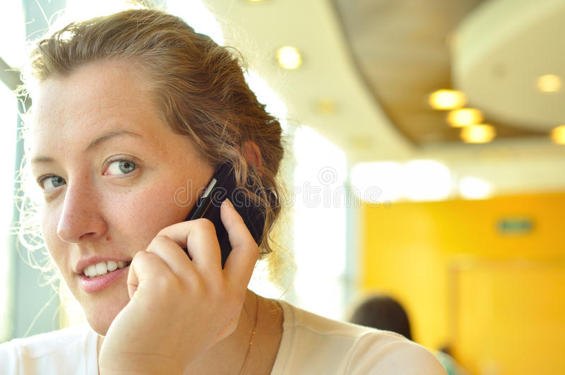 Young Woman Is Talking Phone Stock Images