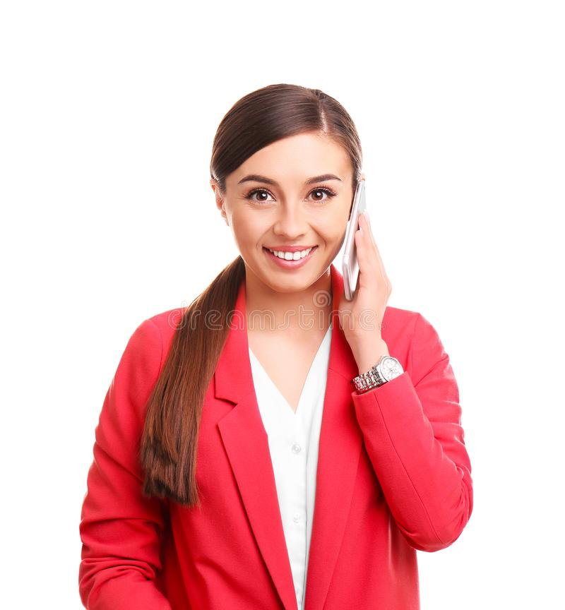 Young woman talking on phone. Against white background stock photography