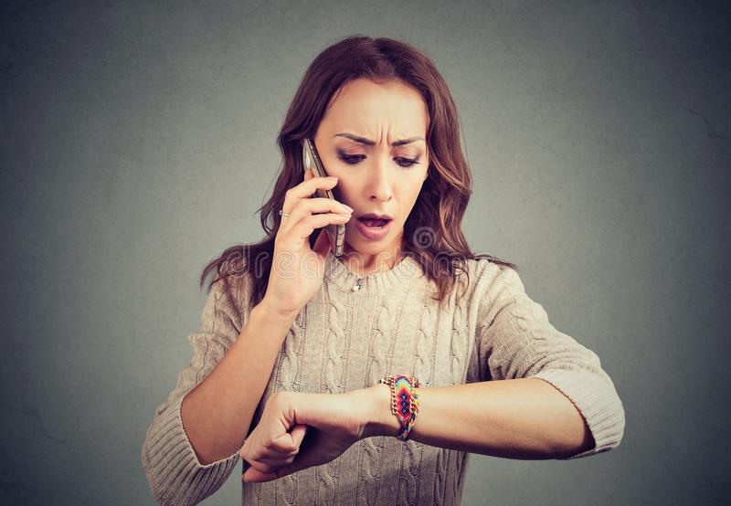 Worried girl having call and being late royalty free stock photos