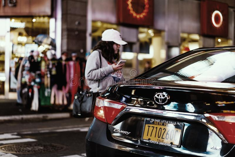 Young woman talking to Uber driver in NY. Uber is very popular in NY almost pushing out all yellow cabs. Driver told me that almost 50 thousand or so Uber royalty free stock photos
