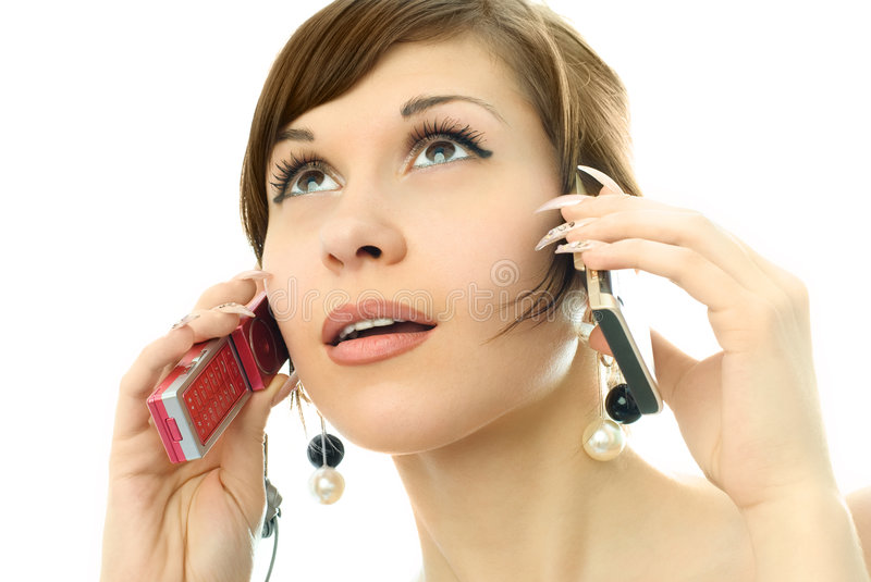 Download Young Woman Talking On Two Cell-phones Stock Image - Image of caucasian, call: 7969537