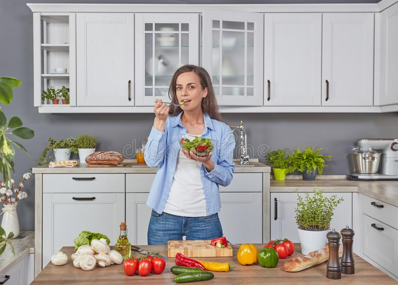 Young woman taste the salad royalty free stock image