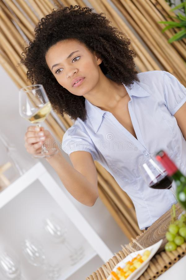 Young woman tasting wine in cellar royalty free stock photos
