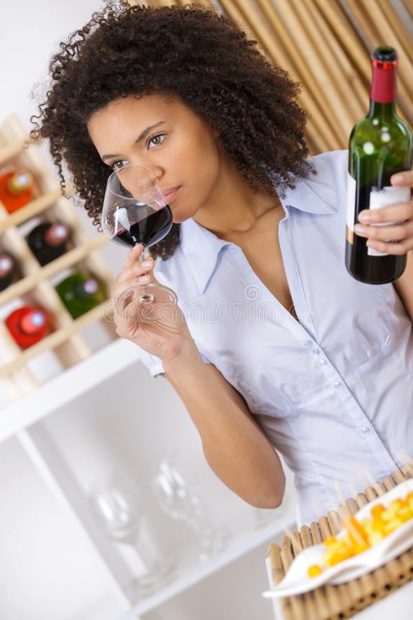 Young woman tasting wine royalty free stock photography
