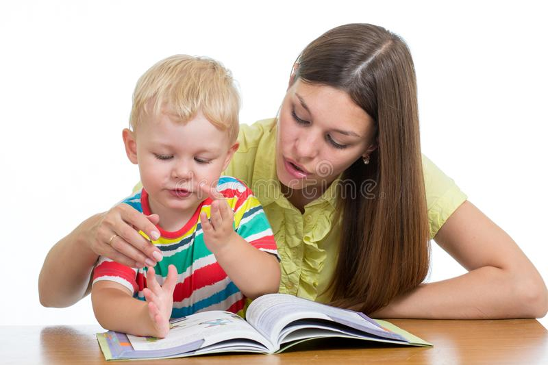 Young woman teacher and little child on private lesson stock image
