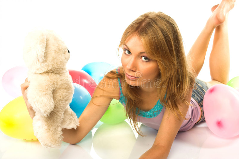 Young woman with teddy stock photo