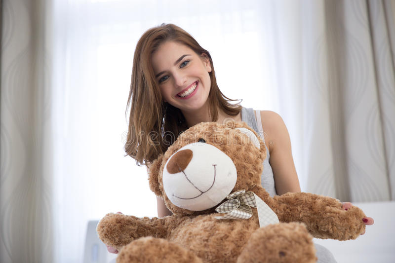 Young woman with teddy bear royalty free stock image