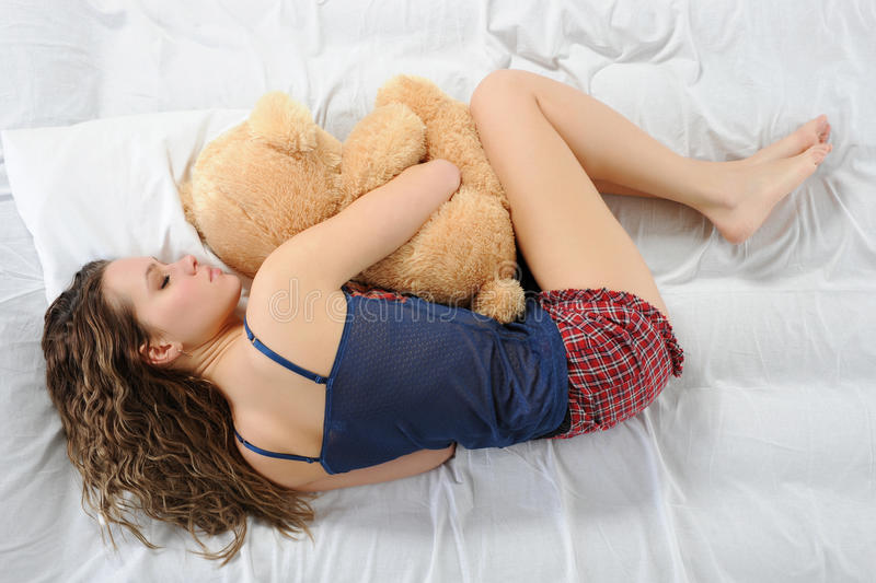 Young Woman With Teddybear Stock Photography
