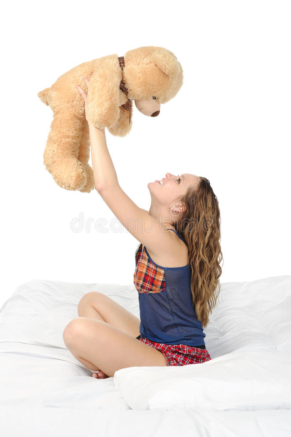 Download Young woman with teddybear stock image. Image of companion - 18096823