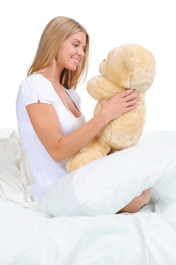 Download Young woman with teddybear stock photo. Image of holding - 21936166