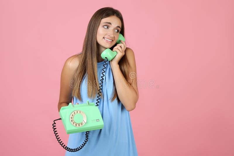 Young woman with telephone stock photo