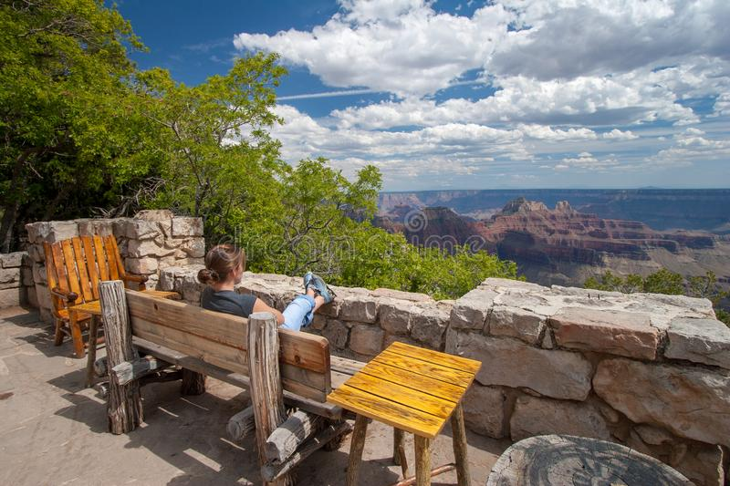 Young woman on terrace of Grand Canyon Lodge. Young woman on terrace o Grand Canyon Lodge on north rim of Grand Canyon enjoying scenery on beautiful summer day royalty free stock photo