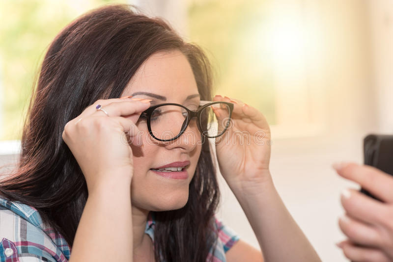 Young woman testing new glasses, light effect stock image