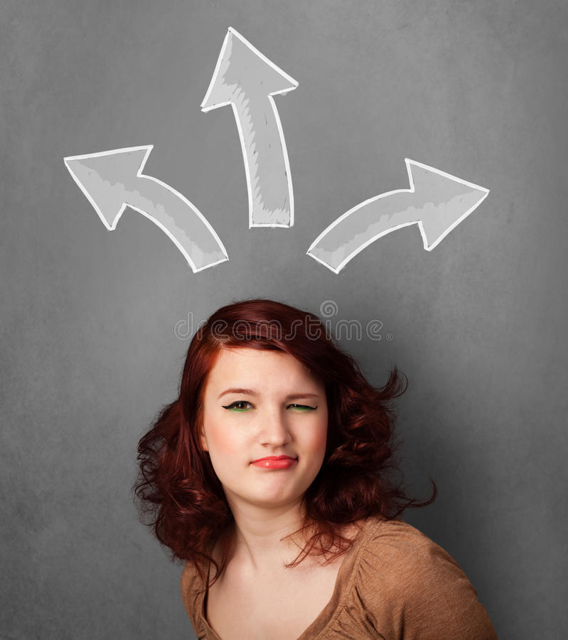 Young woman thinking with arrows above her head. Pretty young woman deciding with sketched arrows above her head royalty free stock photos