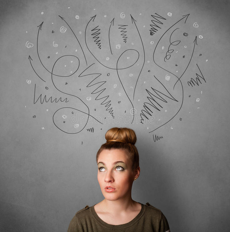 Young woman thinking with arrows over her head. Pretty young woman deciding with sketched arrows over her head stock images