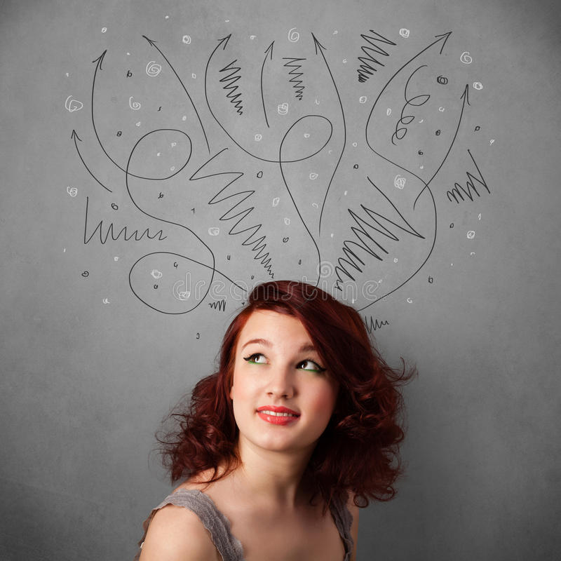 Young woman thinking with arrows over her head. Pretty young woman deciding with sketched arrows over her head stock photography
