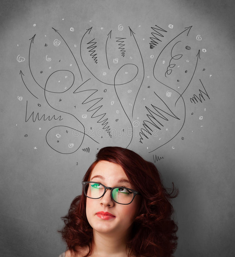 Young woman thinking with arrows over her head. Pretty young woman deciding with sketched arrows over her head royalty free stock photo