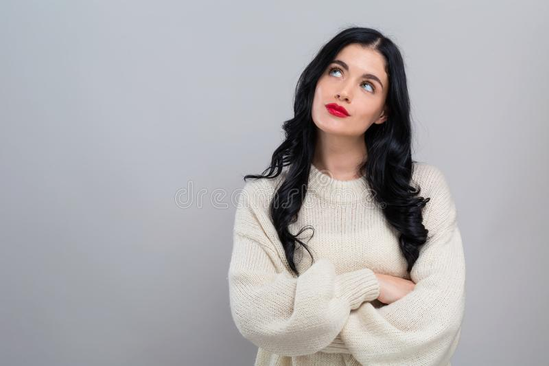 Young woman in a thoughtful pose stock image