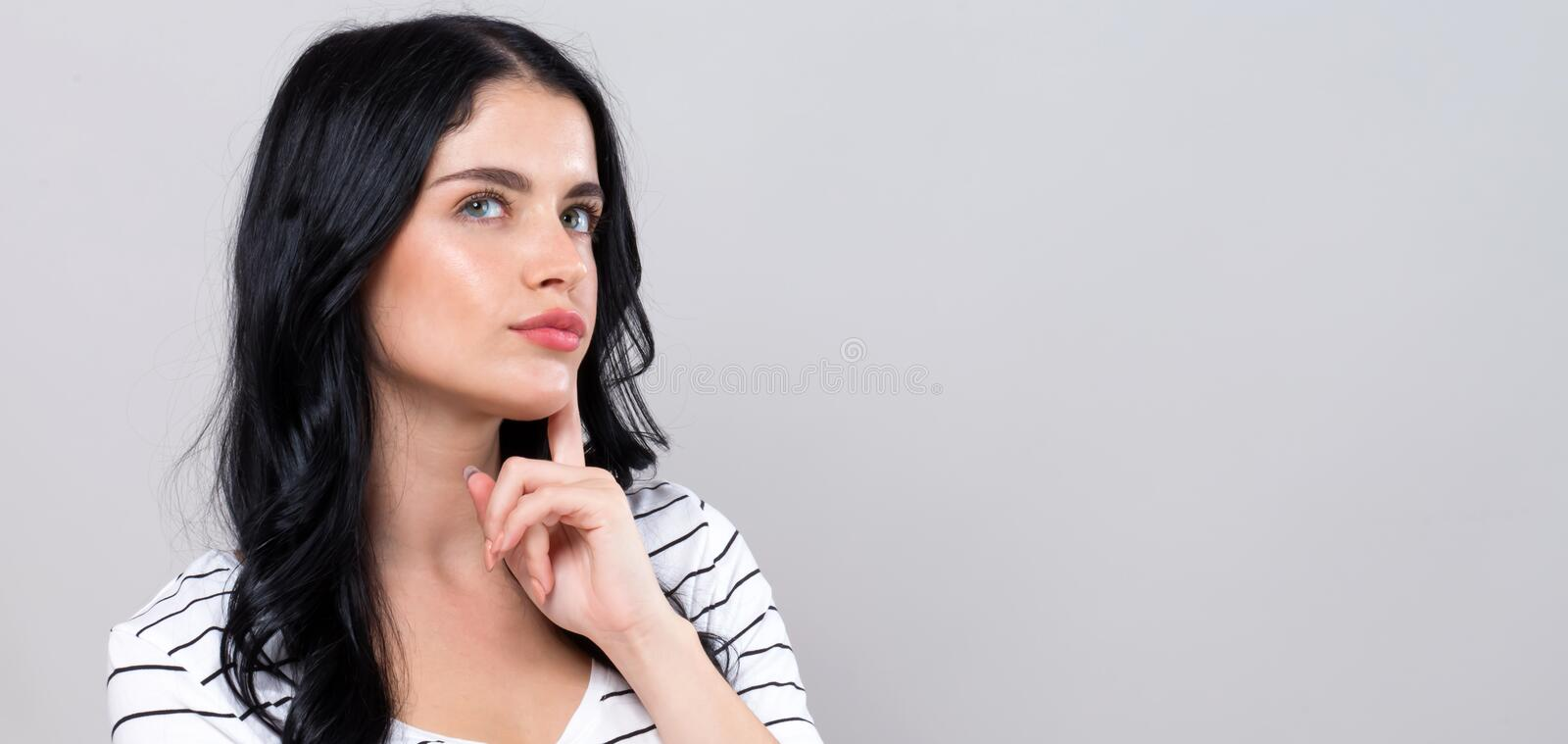 Young woman in a thoughtful pose royalty free stock photos