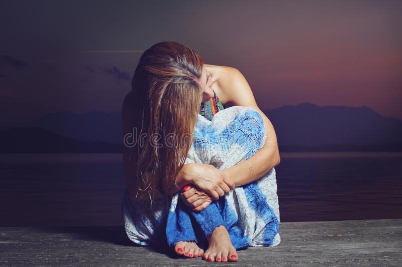 Young woman in thoughtful position royalty free stock photos