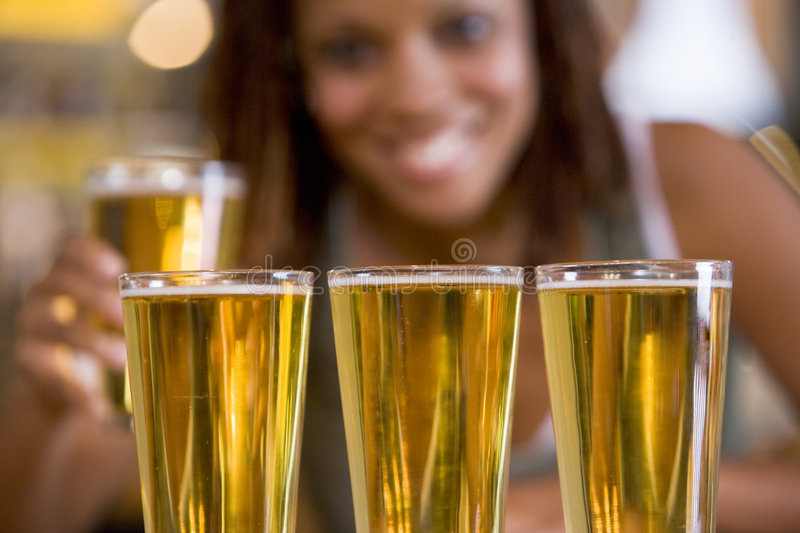 A young woman with three beers in row stock photos