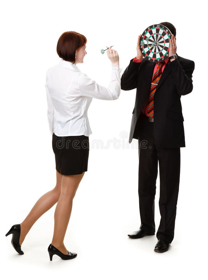 Young woman throwing darts stock photography
