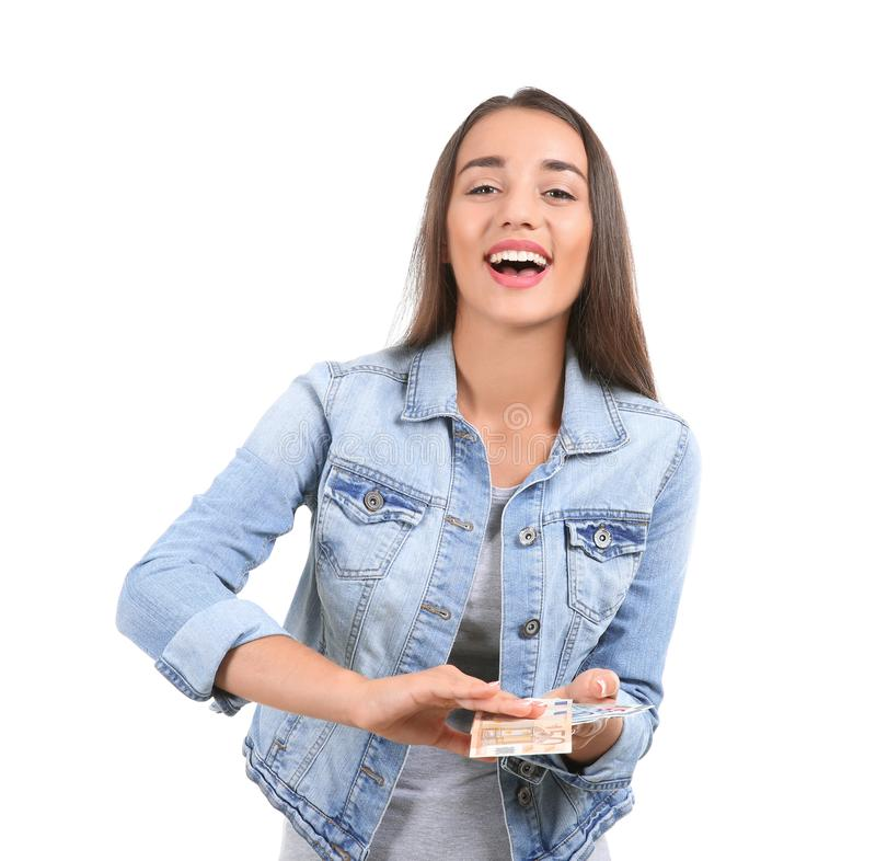 Young woman throwing money on white background royalty free stock image
