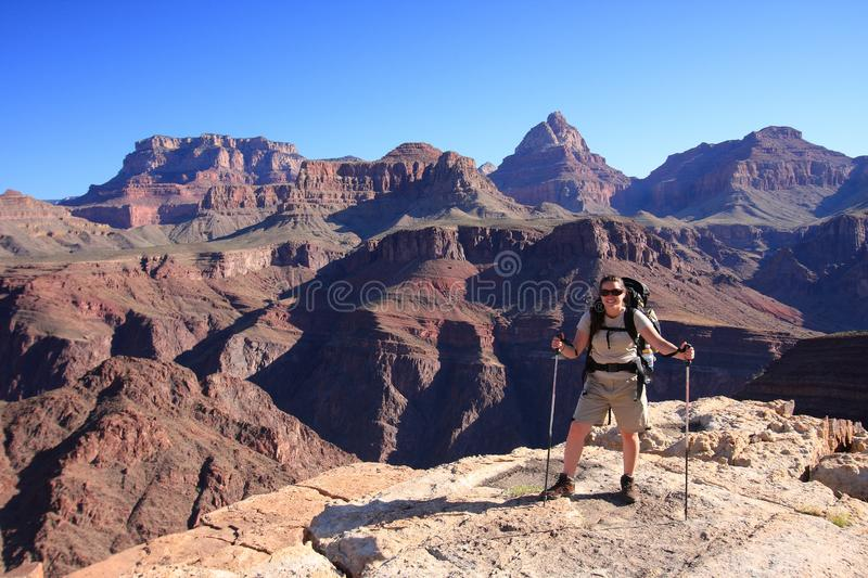 Young woman on the Tonto Trail in the Grand Canyon. Young woman backpacker on the Tonto Trail in Grand Canyon National Park, Arizona stock image