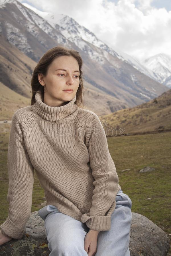 Young woman on the top in the mountains stock photography