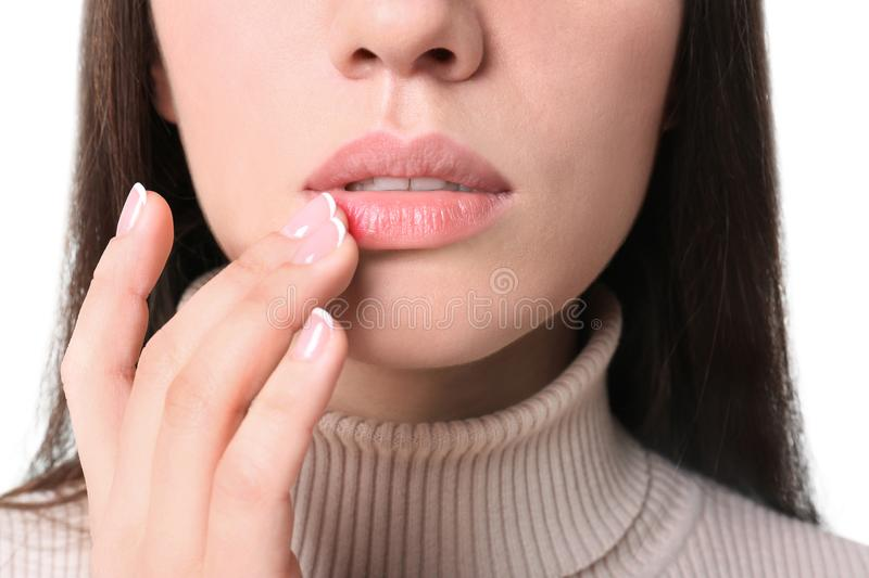 Young woman touching lips stock photo