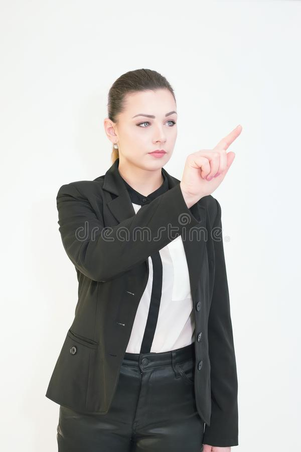 Young woman touching virtual screen over white. stock photography