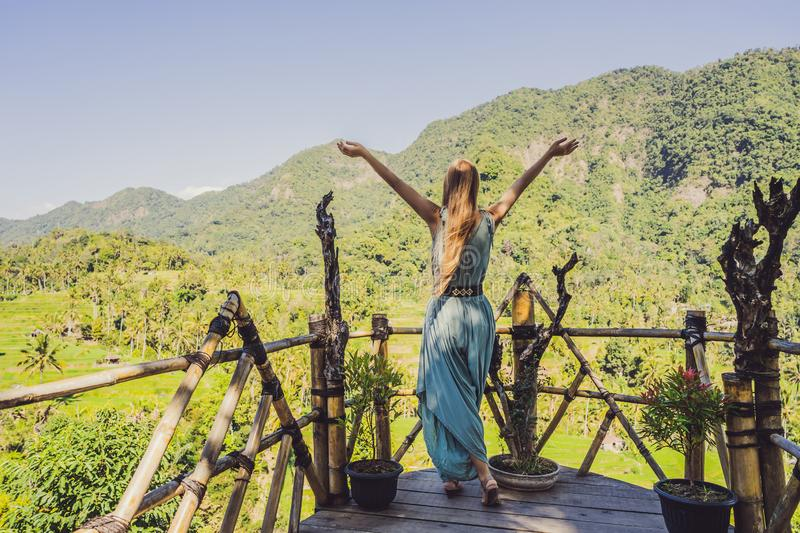 Young woman tourist on background of Tropical jungle of bali. Forest and mountain. Bali Travel Concept stock photography