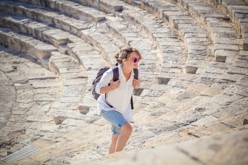 Young woman tourist with a backpack on the background of the ste royalty free stock photo