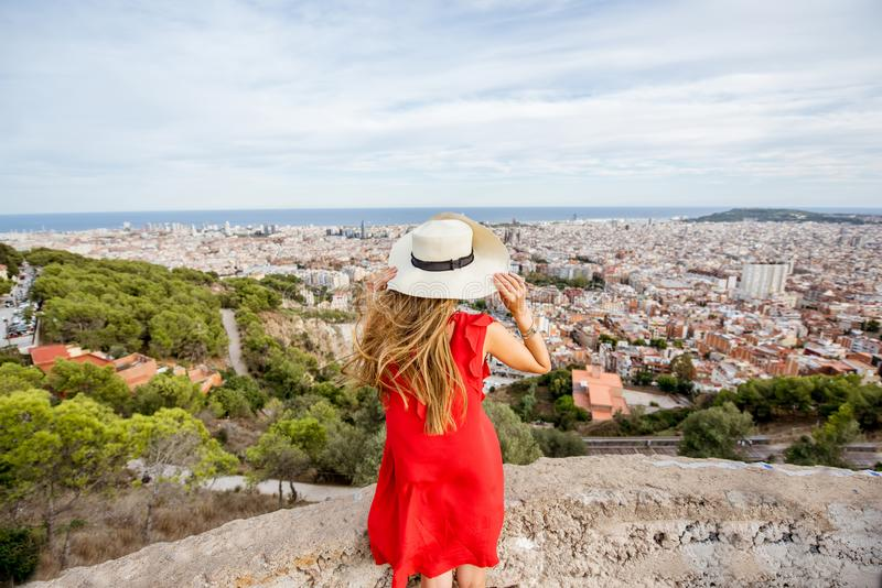 Woman traveling in Barcelona. Young woman tourist in hat enjoying great cityscape view on Barcelona royalty free stock images