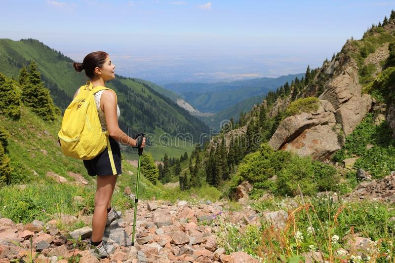 Young woman tourist standing in the mountains stock photos