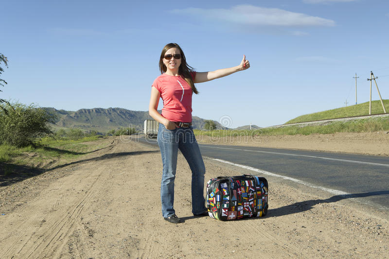 Young woman tourist on the track royalty free stock photos