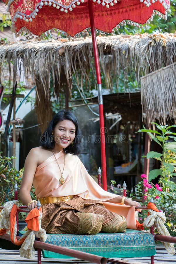 Young woman in traditional Thai clothes royalty free stock photo