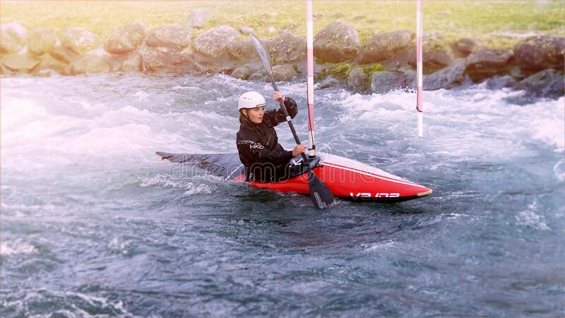 Young woman training in canoe kayak stock image