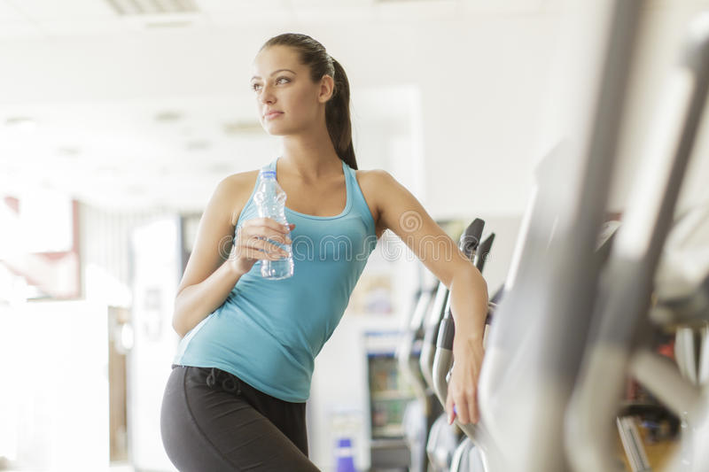 Young woman training in the gym. Young woman on a treadmill at the gym stock photos