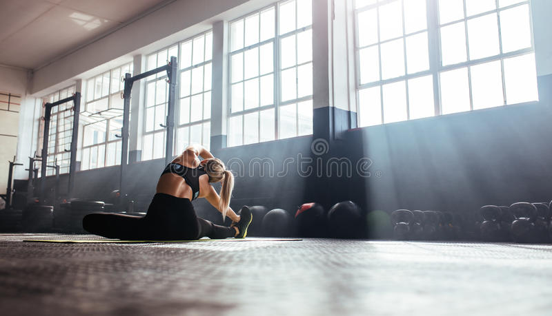 Young woman training in gymnasium. royalty free stock photo