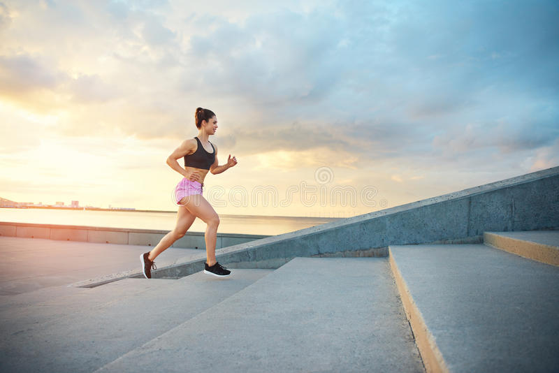 Young woman training on a morning run stock photography