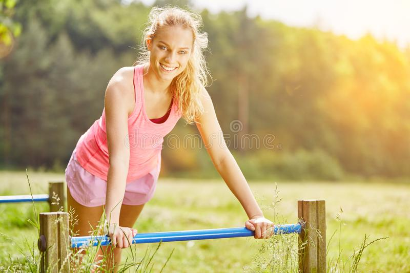 Young woman training in the park royalty free stock photo