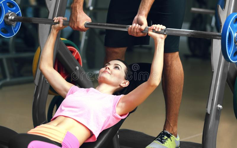 Young woman training with personal coach stock images