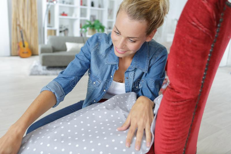 Young woman training to become upholsterer royalty free stock photo