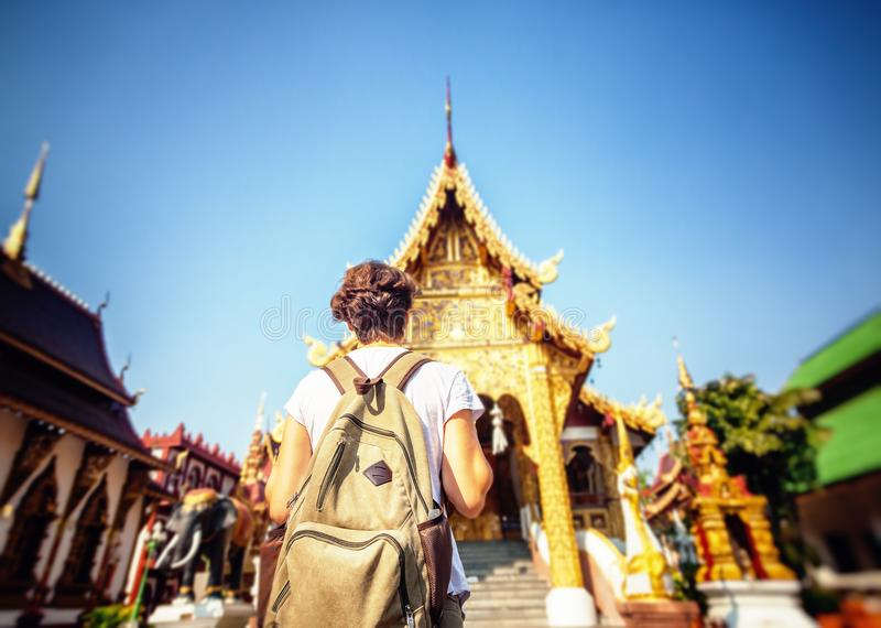 A young woman travel to Thailand, visiting the sights. Buddhist stock photos