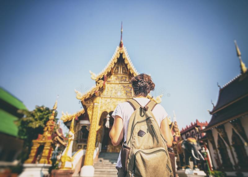 A young woman travel to Thailand, visiting the sights. Buddhist stock photography