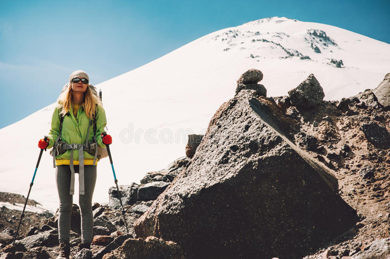 Young Woman traveler with backpack hiking royalty free stock photography